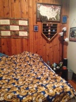 One side of my bedroom. I love the log cabin-esq feeling I get from the wall.